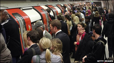 Crowded tube train - commuters