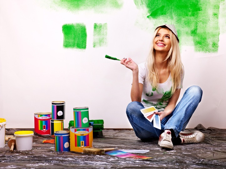 Woman painting new home